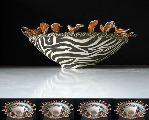 Keramiek. Aardewerk schaalvorm opgebouwd uit ringen. De rand bestaat uit bolletjes en vogelvormen, stuk voor stuk met de hand gemaakt. Bewerkt met engobes en glazuren.